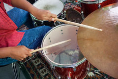 Midsection Of Female Drummer Performing Stock Photo