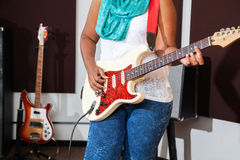 Midsection Of Female Performer Playing Guitar Stock Images