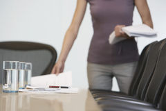 Midsection Of Female Worker Arranged Documents On Conference Table Stock Photography