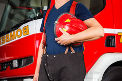 Midsection Of Fireman Holding Red Helmet Stock Images