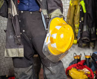 Midsection Of Firewoman Holding Helmet At Fire Royalty Free Stock Photography