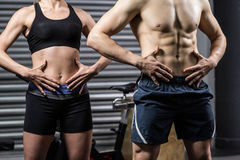 Midsection of fit couple posing Stock Photo