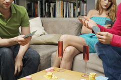 Midsection Of Friends Playing Cards Royalty Free Stock Photography