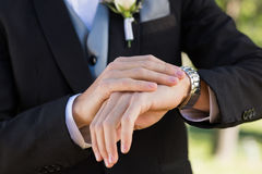 Midsection of groom checking time Stock Photo