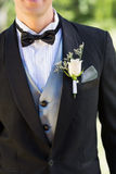 Midsection of groom wearing boutonniere Royalty Free Stock Photos