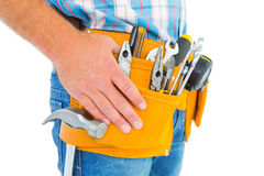 Midsection of handyman wearing tool belt Royalty Free Stock Images