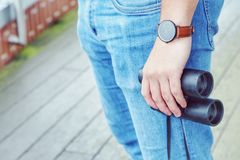 Binoculars. Midsection of a hipster with binoculars Stock Image