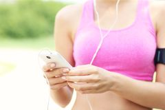 Midsection of a jogger with smartphone Stock Photos