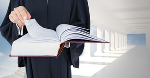 Midsection of judge holding law book Royalty Free Stock Images