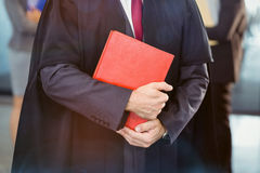 Midsection of lawyer holding law book. In office Royalty Free Stock Photo