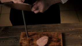 Midsection of Male Chef Sharpening Knife In Commercial Kitchen stock video