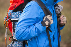 Midsection of male hiker carrying backpack outdoors Royalty Free Stock Image