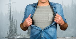 Midsection of male hipster pulling his shirt like superhero Stock Photos