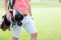 Midsection of man carrying golf club bag at course Royalty Free Stock Images