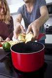 Midsection of man cooking pasta in kitchen Stock Photography