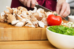 Midsection Of Man Cutting Mushrooms Stock Photography