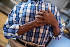 Midsection of man with hand on chest suffering from chest pain. While standing at home stock images