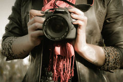 Midsection of Man Holding Camera Royalty Free Stock Images