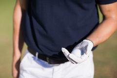 Midsection of man holding golf ball Royalty Free Stock Image