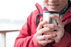 Midsection of man holding insulated drink container during winter Royalty Free Stock Photo