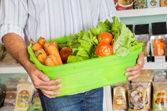 Midsection Of Man Holding Vegetable Basket Stock Photography