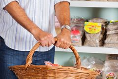 Midsection Of Man Holding Wicker Basket Royalty Free Stock Photo