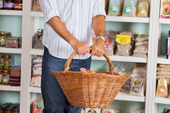 Midsection Of Man Holding Wicker Basket In Store Stock Photos