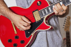 Midsection of man playing electric guitar Stock Photos