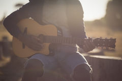 Midsection of man playing guitar Royalty Free Stock Photos
