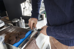 Midsection of man preparing coffee at mobile coffee shop Stock Photo