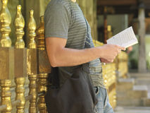 Midsection Of Man Reading Book Royalty Free Stock Images