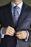 Midsection Of Man In Suit Buttoning Button On Coat Stock Image