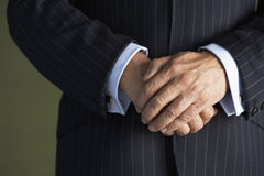 Midsection Of Man In Suit With Hands Clasped Stock Photography