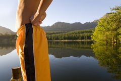 Midsection of man in swim trunks Royalty Free Stock Photo