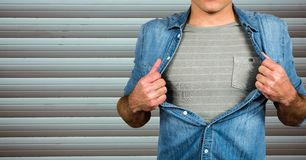 Midsection of man tearing shirt. Digital composite of Midsection of man tearing shirt Royalty Free Stock Photos
