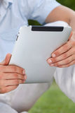 Midsection of man using digital tablet in park Royalty Free Stock Photo