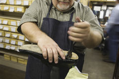 Midsection Of Man Working At Shoemaker Workshop Royalty Free Stock Image