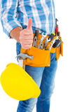 Midsection of manual worker gesturing thumbs up. On white background stock photography