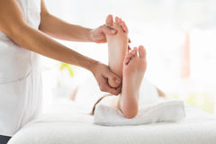 Midsection of masseur giving foot massage to woman Royalty Free Stock Photo