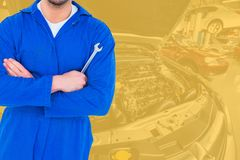 Midsection of mechanic holding spanner Royalty Free Stock Photos