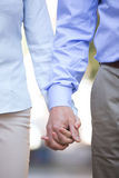 Midsection of middle-aged couple holding hands outdoors Stock Photography