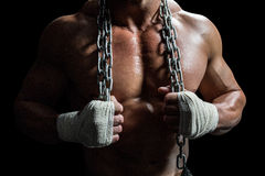 Midsection of muscular man holding chain Stock Images