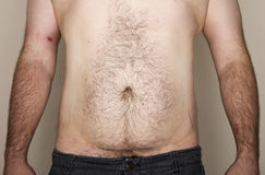 Midsection normale dell'uomo che affronta la macchina fotografica Fotografie Stock