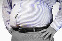 Midsection Of An Obese Man Wearing Tight Formal Shirt  Stock Photo