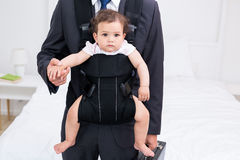 Midsection Of Father Carrying Baby And Briefcase Stock Photos