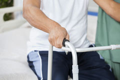Midsection Of Patient With Walker In Rehab Center Stock Photos