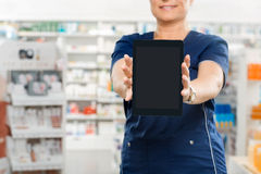 Midsection Of Pharmacist Showing Digital Tablet Royalty Free Stock Photography