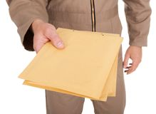 Midsection Of Postman Holding Envelopes Royalty Free Stock Photo