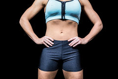 Midsection of powerful woman with hands on hip Royalty Free Stock Photography