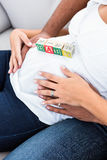 Midsection of pregnant woman belly with toy Stock Images